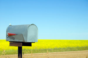 ist2_3935761-mailbox-canola-field-and-copy-space