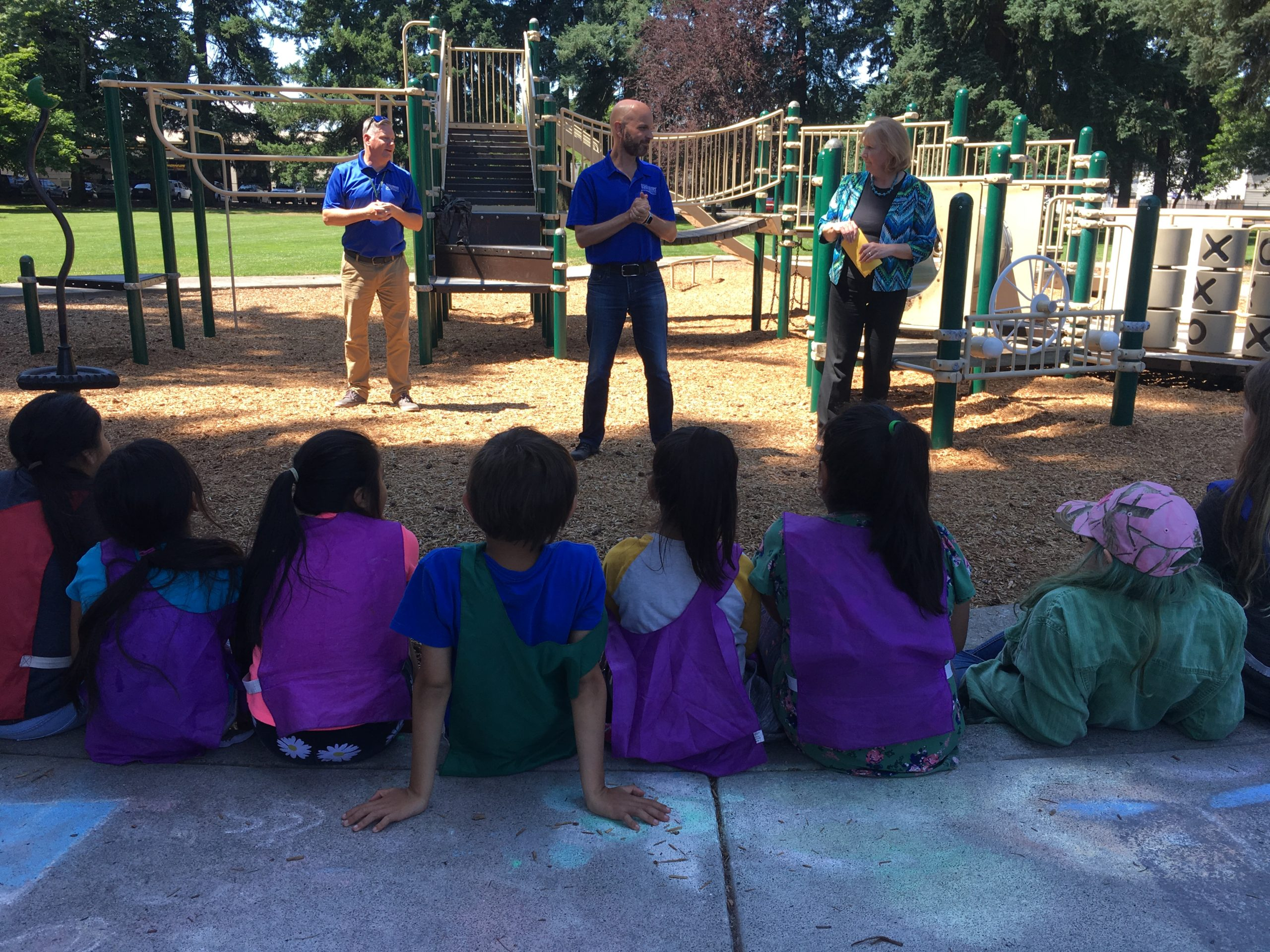 City of Vancouver Mayor Anne McEnerny-Olge and City Council member Ty Stober answer questions from kids who participate in Evergreen Park's Summer Playgrounds Program.
